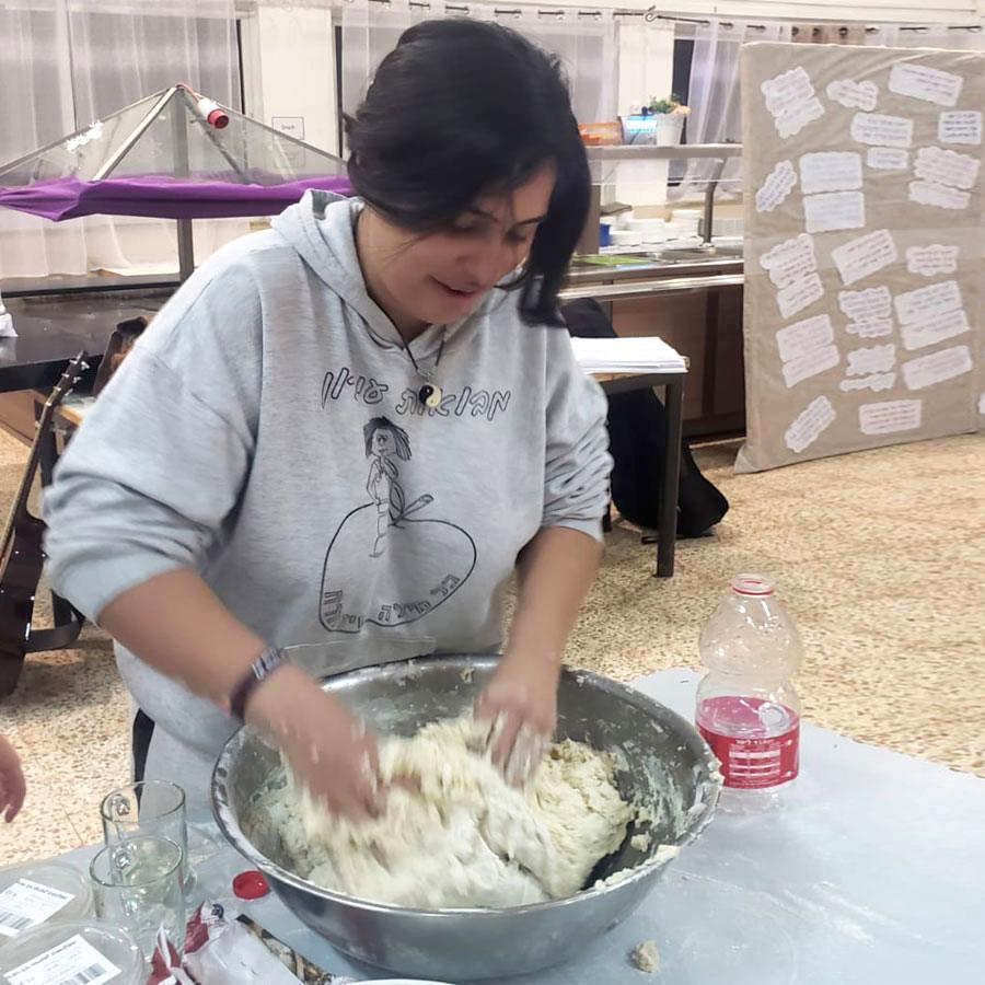 Elisheva, a Ramat Hadassah Youth Village resident, preparing a meal