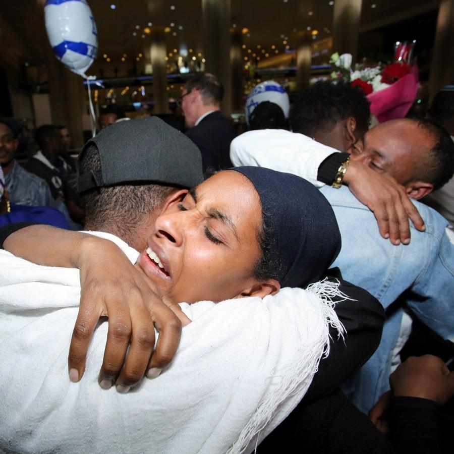 Ethiopian family members hugging after landing in Israel | Photo: Dudi Salem, Zoog Productions, April 2019
