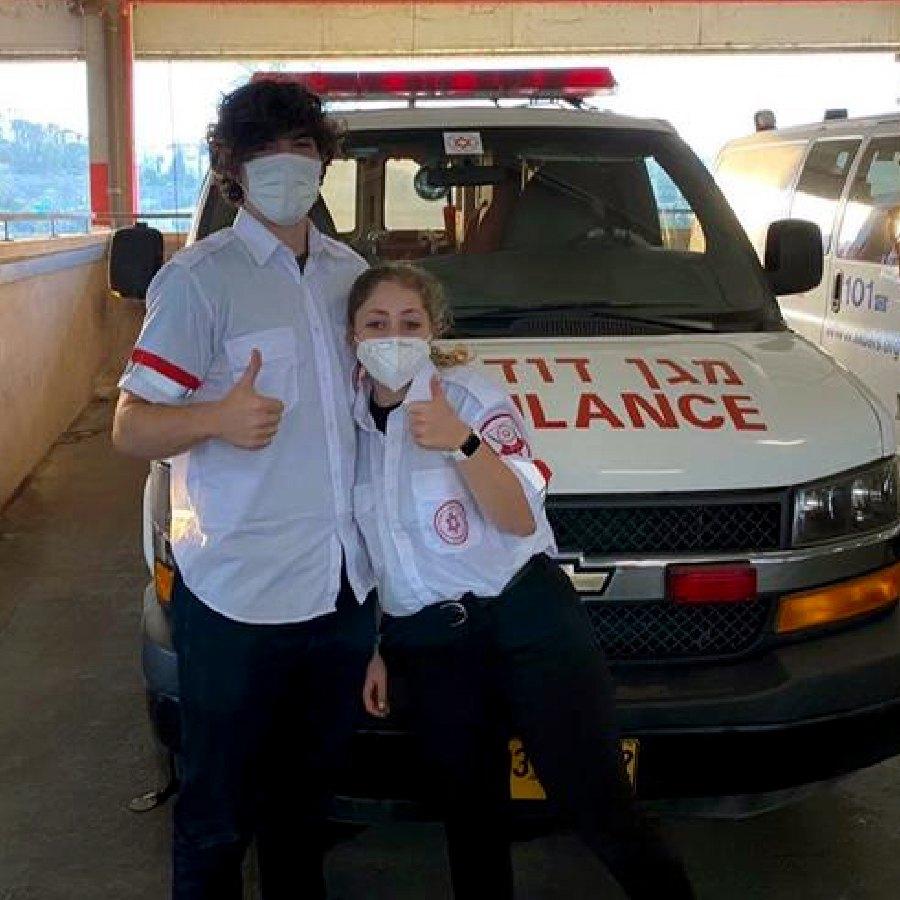 judah in front of ambulance