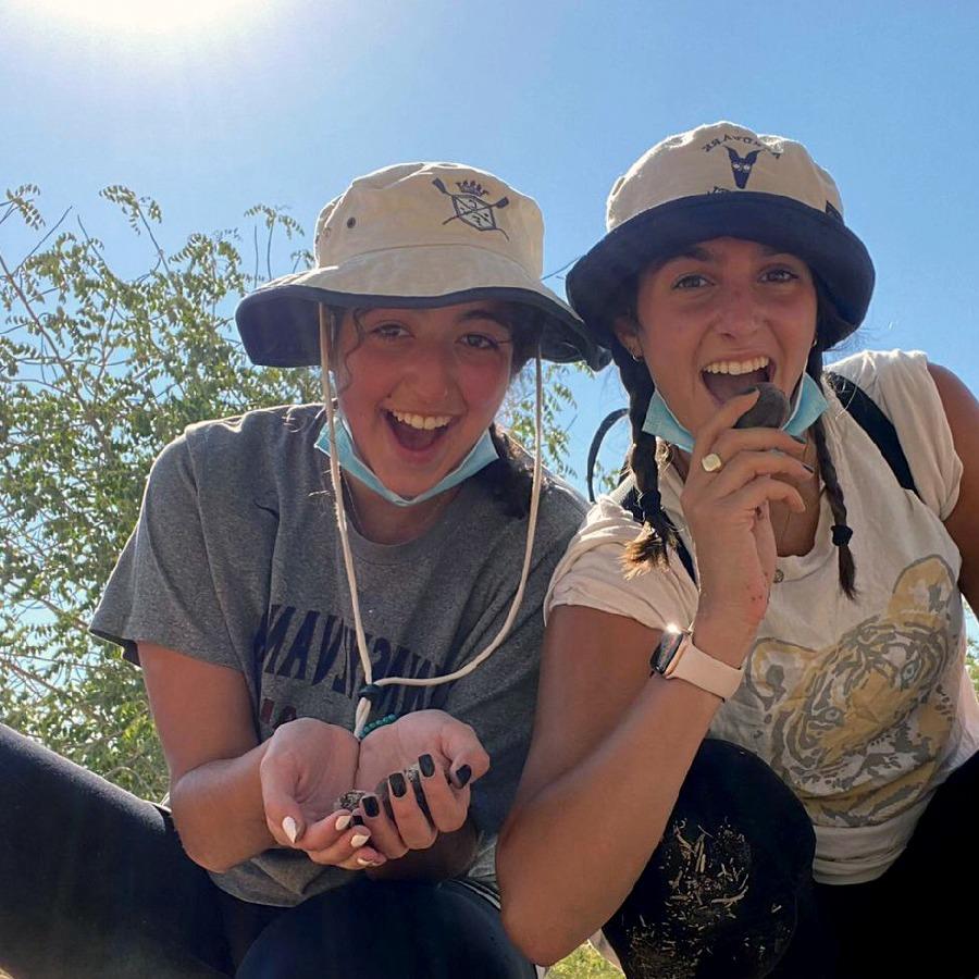 Raquel and a friend volunteering in Israel