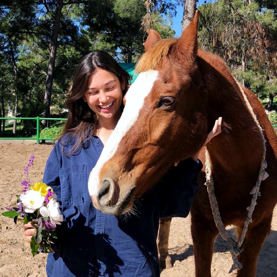 Annamarie with a horse on the kibbutz