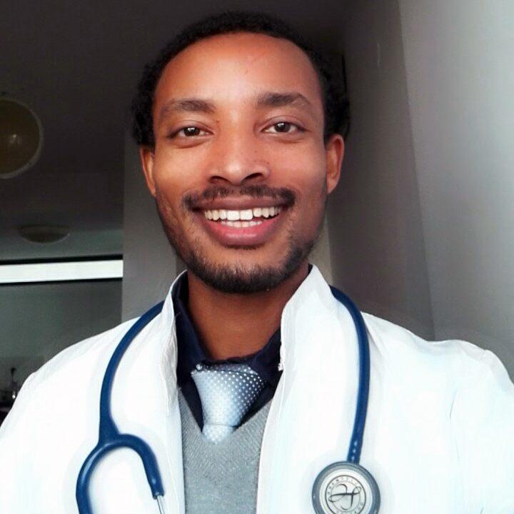 Dr. Masresha in his white coat